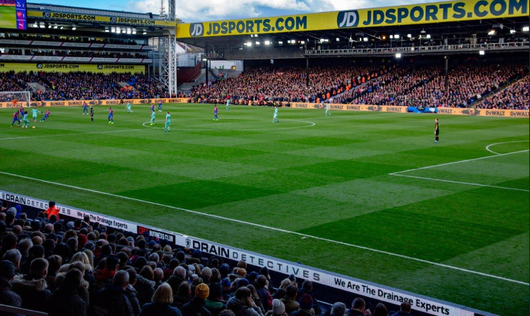 Drain Detectives banner is seen from the Main Stand at Selhurst Park against Arsenal.